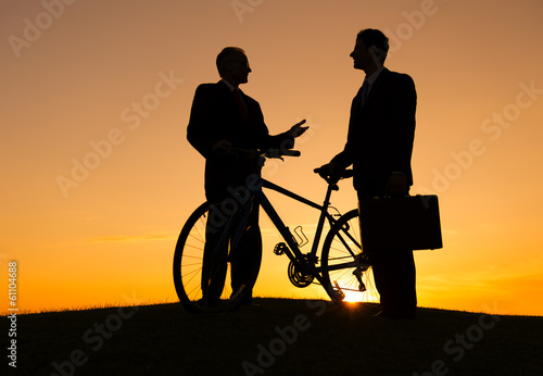 Businessmen with a Bicycle at Sunset