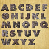 Oak  bark alphabet on wood - upper case
