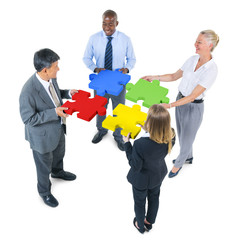 Group of Business People Building Jigsaw
