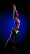 Beautiful naked woman with luminous UV makeup