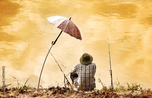fisherman sitting at the mekong