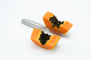 Two piece of papaya is divided by a knife