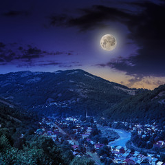 village near the river to forest in mountain at night