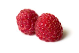 Ripe raspberry on the white background