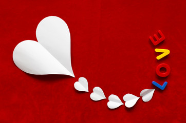 """Heart shaped paper and """"Love"""" word"""