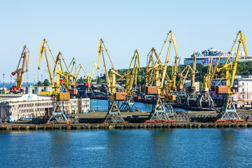 Port cranes in container terminal in Odessa sea port, Ukraine.