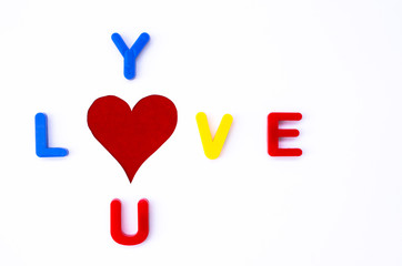 """Love you"" word ,heart shaped hole in paper as ""o"" letter"
