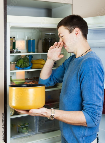 Hungry man holding foul food