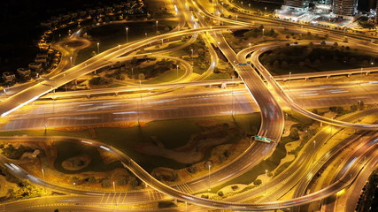 night high light traffic crossroads from the roof in dubai city