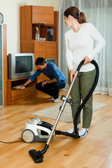 Adult couple doing housework together