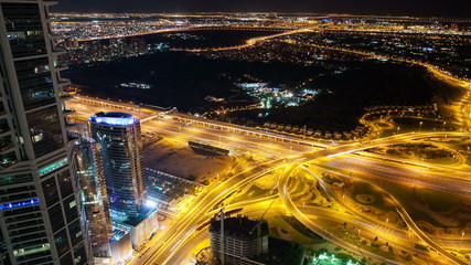 night high traffic crossroads from the roof in dubai city