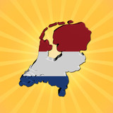Netherlands map flag on sunburst illustration