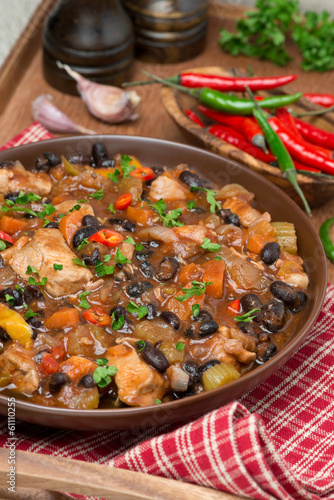 chili with black beans, chicken and vegetables, vertical