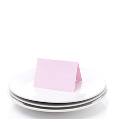 pink card for congratulation on a plate, isolated