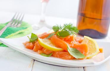 fresh salmon with lemon on the white plate