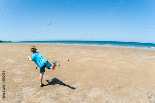 Boy Throwing Boomerang Beach Blue