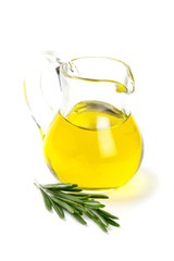 olive oil in a glass patcher and twig of rosemary