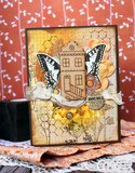 Orange handmade card with a wooden house and a butterfly