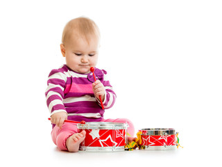 Baby girl playing musical toy