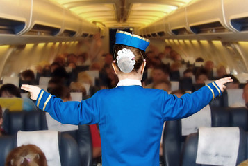 girl in costume stewardess shows the direction
