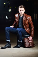 Fashionable young man with leather clothes on