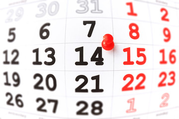 Calendar and red pushpin on 14 February. Valentine's day