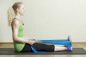 Pilates Instructor using a rubber band exercise