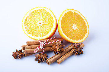Orange fruit segment, cinnamon sticks and mint isolated on white