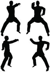 silhouettes of men in reverse punch karate poses