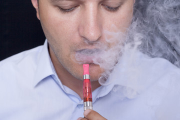 Men smoke an electronic cigarette