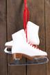 Figure skates on wooden background