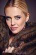 Portrait of beautiful young woman wearing fashionable fur , look