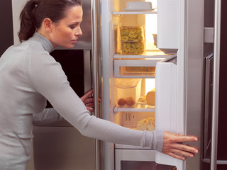 woman in front of the fridge aa
