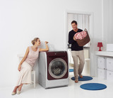 woman and man doing laundry