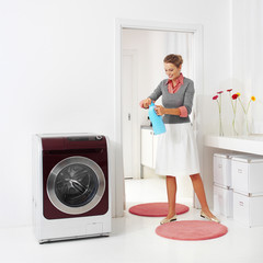 woman doing a housework holding presoak