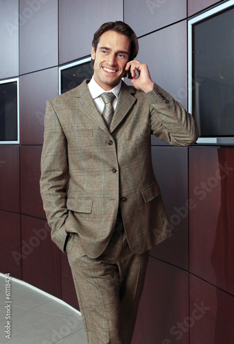 Businessman with mobile phone j