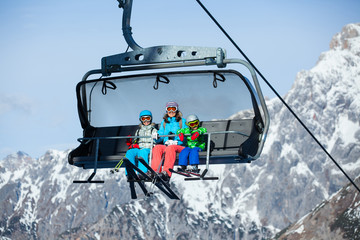Skiers on a ski lift.