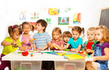 Many kids drawing and gluing poster