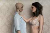 Beautiful young model with a mannequin