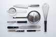 Professional kitchen utensils on white background