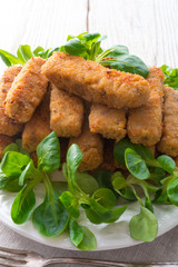home-baked fish sticks with salad