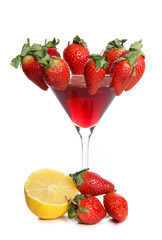 Strawberries and lemon in glass