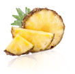Ripe pineapple fruits with slices and green leaves isolated on w