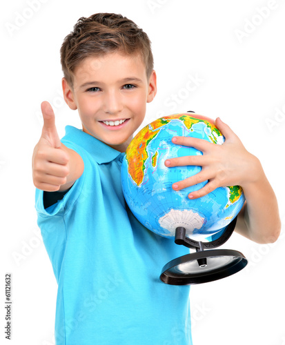 Smiling boy in casual  holding globe with thumbs up