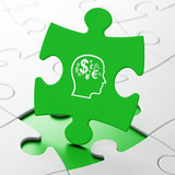 Education concept: Head With Finance Symbol on puzzle background
