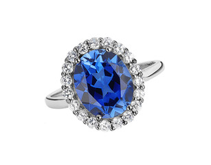 beautiful ring with blue gem (stone) isolated on white backgroun