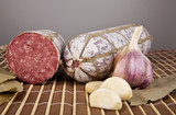 salame, garlic and laurel leaves