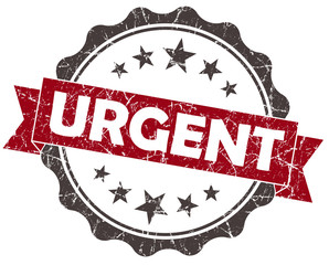 Urgent red grunge vintage seal on white background