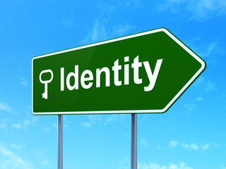 Security concept: Identity and Key on road sign background