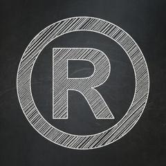 Law concept: Registered on chalkboard background